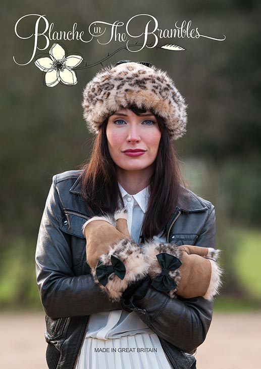 Fashion Cover shot of Young Woman in Fur Hat anfd Glovess